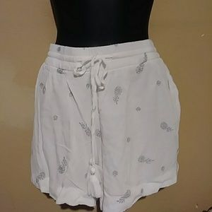 White shorts with silver pineapples..NEW